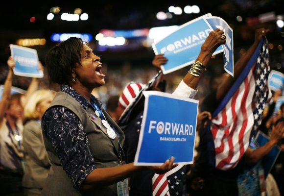 A delegate cheers while US President Barack Obama addresses the final session of the Democratic National Convention