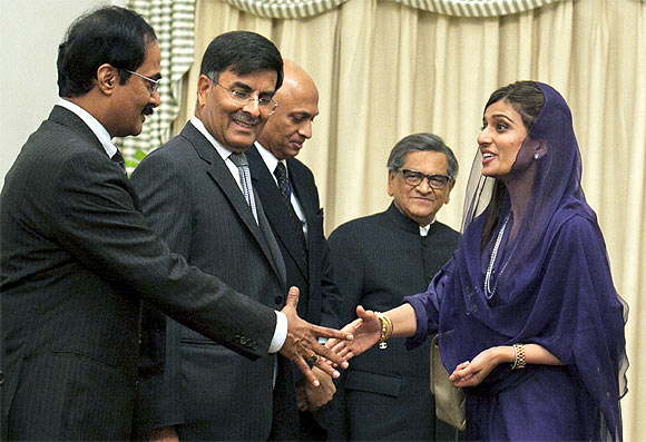 Pakistan's Foreign Minister Hina Rabbani Khar greets the Indian delegation led by Krishna at the prime minister's residence in Islamabad