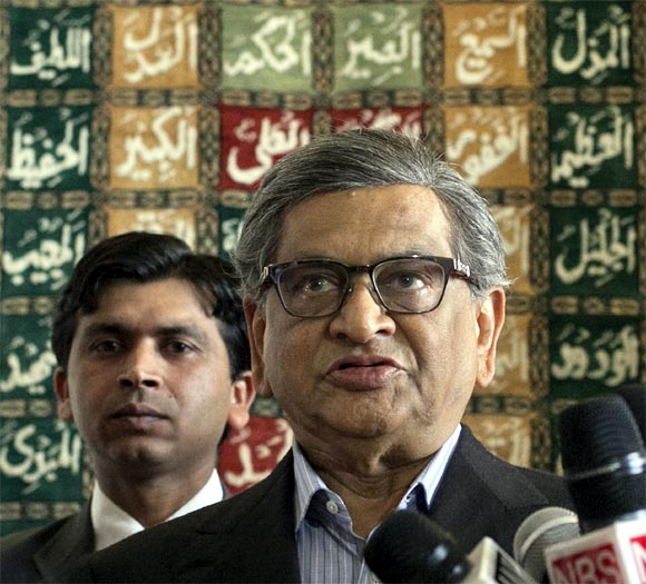 Krishna speaks to the media after his arrival at a military base in Rawalpindi near Islamabad