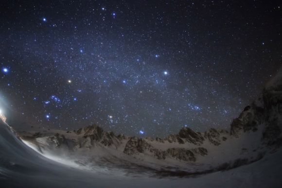 Christmas Stars Diamond: The night sky viewed behind the beautiful Kiso Mountains in Nagano, Japan. The image captures the misty band of the Milky Way and the familiar stars of Orion rise above the peaks to the left of the picture. From left to right the stars Sirius, Betelgeuse and Capella are particularly prominent.