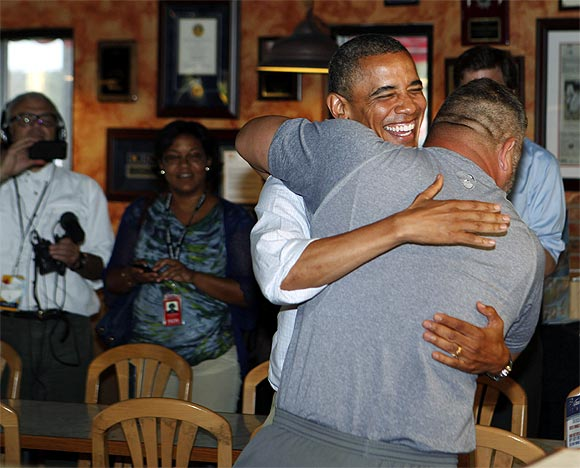 Obama hugs Scott Van Duzer at Big Apple Pizza and Pasta Italian Restaurant in Fort Pierce, Florida
