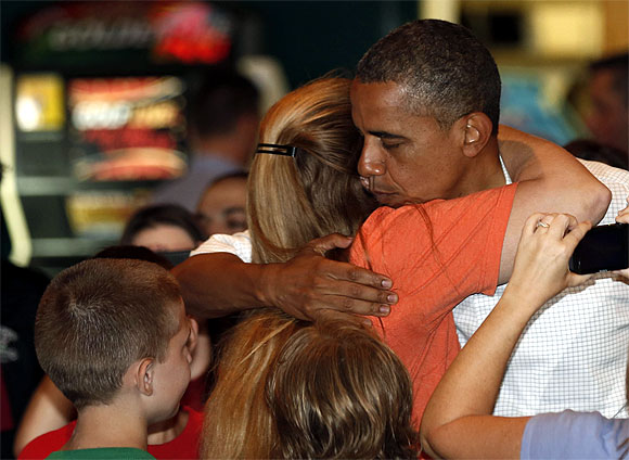 Obama hugs a supporter at the Gator's Dockside restaurant while campaigning in Orlando, Florida