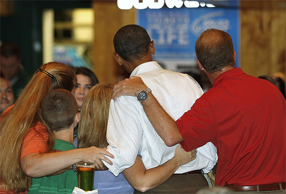 Obama stops to pose with a family at the Gator's Dockside restaurant while campaigning