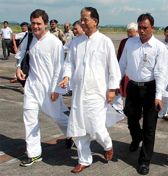 Rahul and Gogoi at the Guwahati airport prior to their visit to Gossaigaon, Kokrajhar