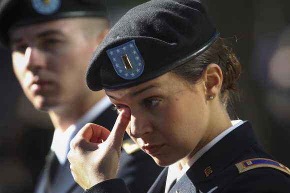 US Army Second Lieutenant Michelle Mudge wipes a tear during ceremonies marking the 11th anniversary of the 9/11 attacks