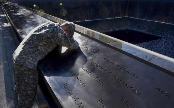 Scott Willens, who joined the US army three days after 9/11, pauses while reflecting by the South Pool on friends he has lost Scott Willens, who joined the United States army three days after the attacks on 9/11, pauses while reflecting by the South Pool on friends he has lost