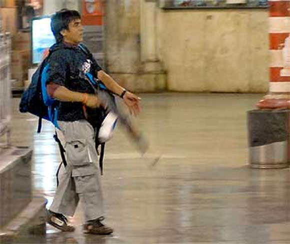 Ajmal Kasab during his macabre killing spree at Mumbai's CST on the night of 26/11