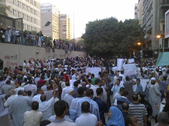 People attend a rally in front of the US embassy in Cairo