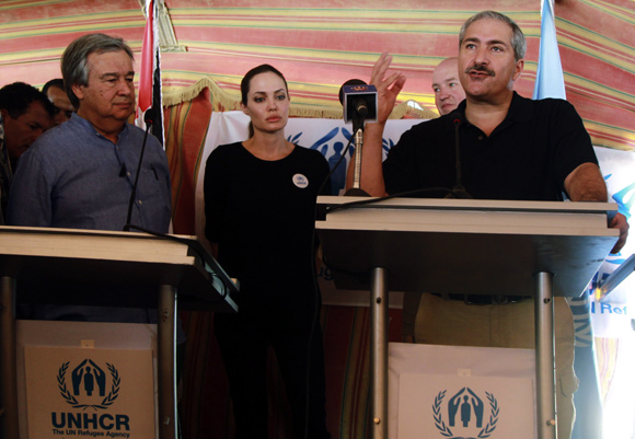 The UN refugee agency's special envoy, actress Angelina Jolie, attends a news conference with U.N. High Commissioner for Refugees (UNHCR) Antonio Guterres (L) and Jordan's Foreign Minister Nasser Judeh (R) at Al Zaatri refugee camp in the Jordanian city of Mafraq.
