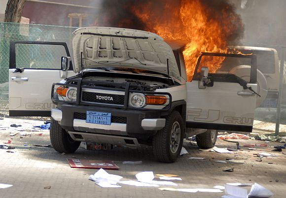 A vehicle burns at the US embassy in Sanaa on September 13, 2012