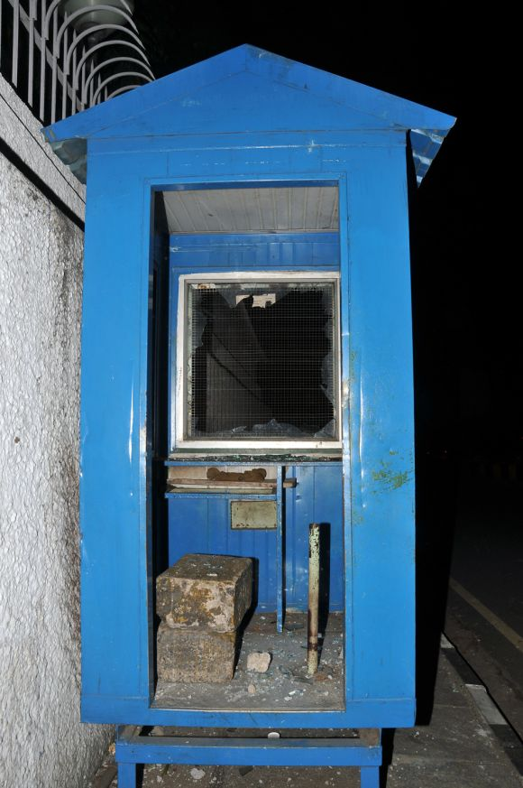 A damaged security cabin at the main entrance of the US consulate in Chennai