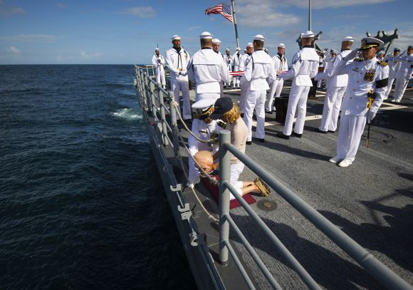 Carol Armstrong, wife of Neil Armstrong, commits the remains of Armstrong to sea during a burial at sea service held onboard the USS Philippine Sea in the Atlantic Ocean