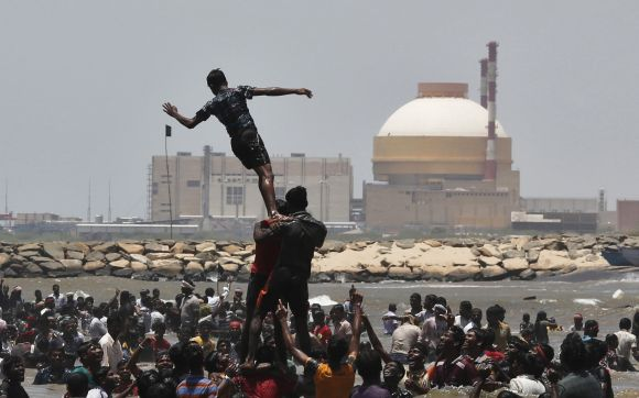 Demonstrators form a human pyramid in the waters of the Bay of Bengal, as they shout slogans during a protest near the Kudankulam nuclear power project