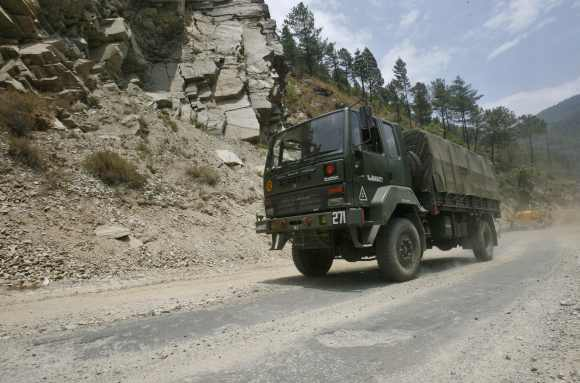 An Indian army truck drives along India's Tezpur-Tawang highway, which runs to the Chinese border, in Arunachal Pradesh