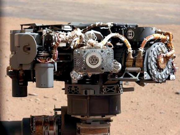 This image shows the Alpha Particle X-Ray Spectrometer on NASA's Curiosity rover, with the Martian landscape in the background