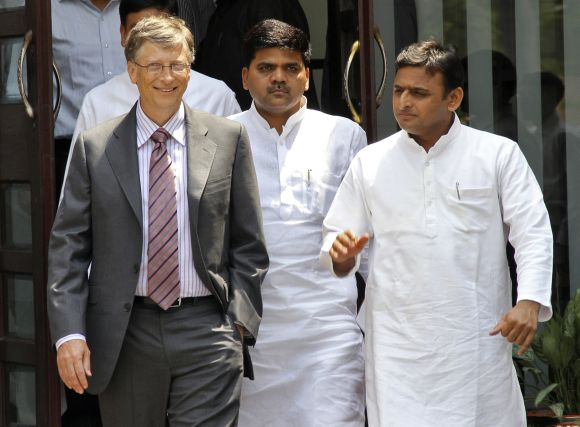 Akhilesh Yadav talks with Microsoft co-founder Bill Gates after their meeting in Lucknow