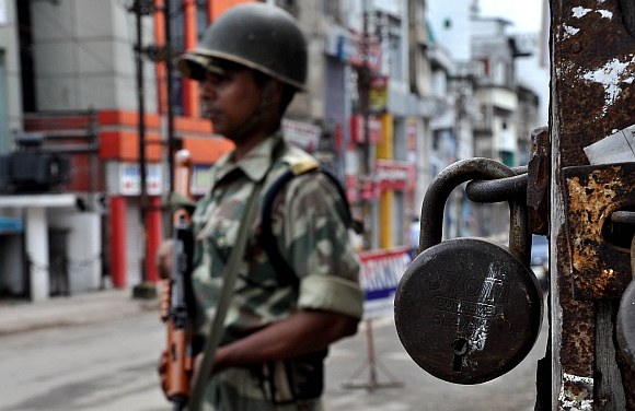 A CRPF jawan stands guard at Fancy bazar in Guwahati