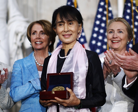 Myanmar opposition leader Aung San Suu Kyi is presented with the Congressional Gold Medal at the United States Capitol in Washington