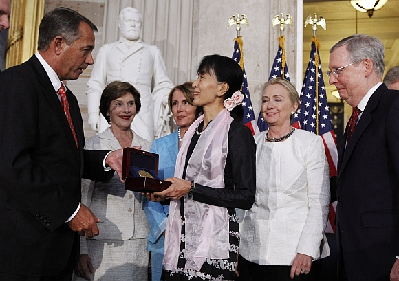 Suu Kyi is presented with the Congressional Gold Medal by House Speaker John Boehner at the U S Capitol in Washington. Also present at the ceremony are: (left to right) former first lady Laura Bush, House Minority Leader Nancy Pelosi, Secretary of State Hillary Clinton and Senate Minority leader Mitch McConnell