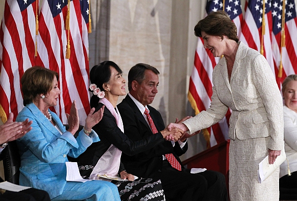 Suu Kyi is congratulated by former U S first lady Laura Bush at the ceremony