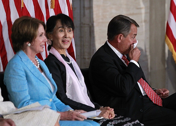 Suu Kyi reacts as House Speaker John Boehner cries during the ceremony