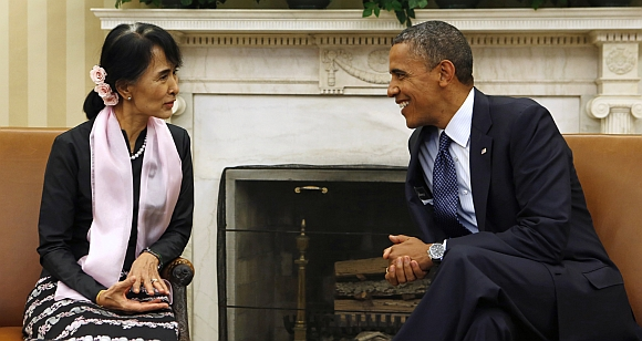 US President Barack Obama speaks with Myanmar Suu Kyi during their meeting in the Oval Office of the White House in Washington