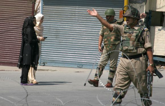 Police tighten security as protests continue in Kashmir
