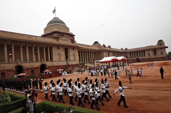 Indian soldiers at Rashtrapati Bhavan present a guard of honour to President Pranab Mukherjee