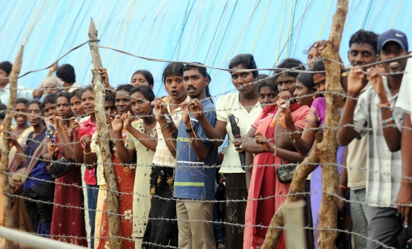 Displaced Tamil civilians at the Manik Farm refugee camp