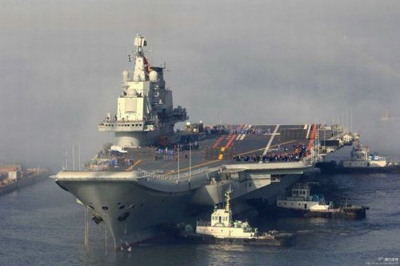 China gets its first aircraft carrier amidst tensions with Japan