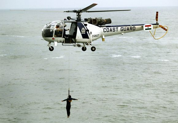 Indian Coast Guard 'Chetak' helicopter takes part in a demonstration near Mumbai coast