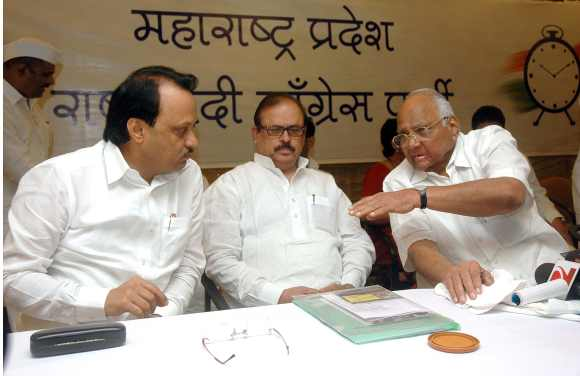 Sharad Pawar interacts with NCP General Secretary Tariq Anwar and nephew Ajit