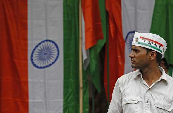 A supporter of Hazare partcipates in a rally against corruption in New Delhi