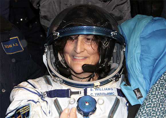 Sunita Williams smiles after landing near the town of Arkalyk, in northern Kazakhstan
