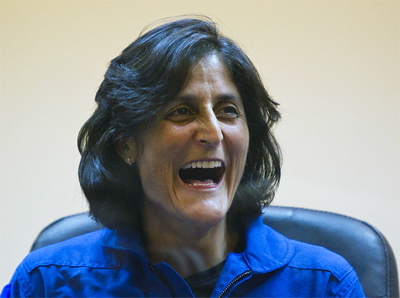 Sunita Williams reacts during a news conference at the Baikonur Cosmodrome