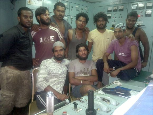 Rakesh Kumar with other crewmen on board Royal Grace while being held hostage