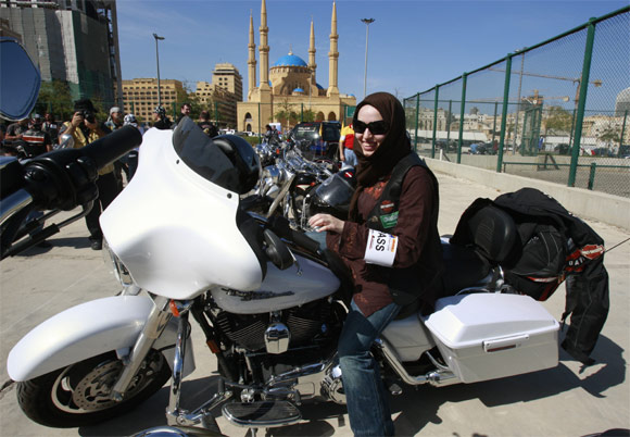 A female Harley-Davidson owner from Saudi Arabia sits on her bike in downtown Beirut before the start of the first Lebanon Harley Tour