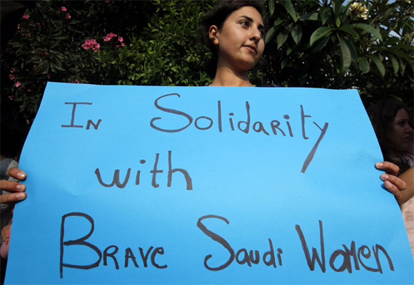 An activist holds a placard expressing solidarity with Saudi women in their fight for basic civil rights and their right to drive in front of the Saudi embassy in Beirut