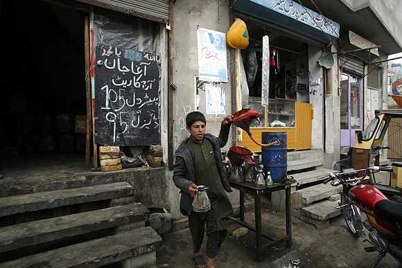 A boy sells petrol at a shop along a roadside in Quetta