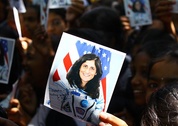 Students hold up pamphlets signed by Sunita Williams
