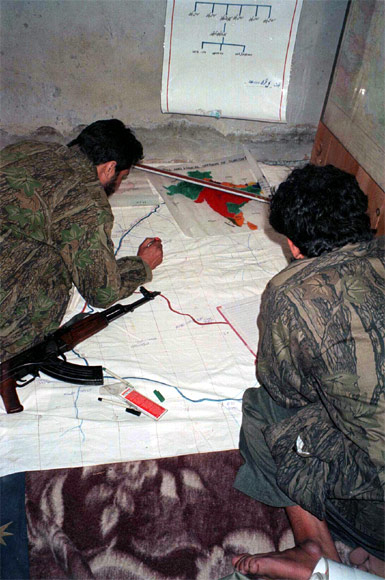 Militants of the LeT study a map of a target inside Jammu and Kashmir