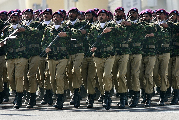 Commandos from the Special Service Group march during Pakistan's National Day military parade in Islamabad