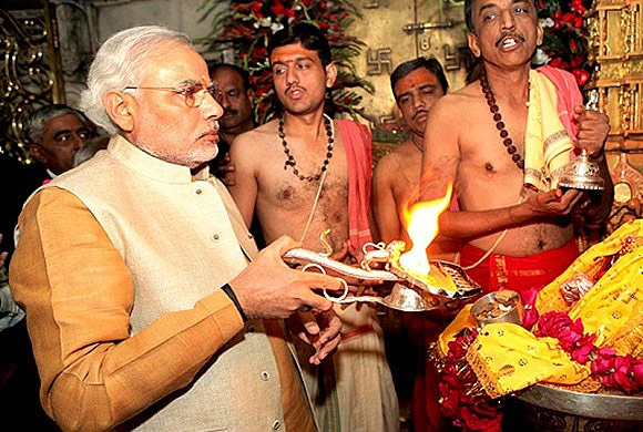 Modi performs a puja at a temple town of Ambaj