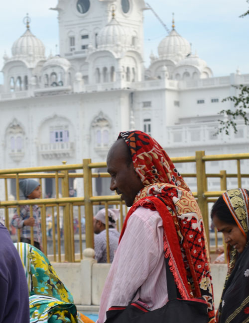 A group of Bengali tourists take in their first sight of the Golden Temple