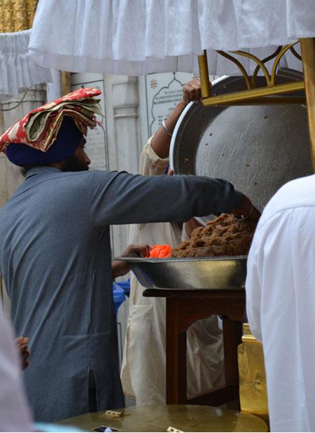 Volunteers hand out prasad