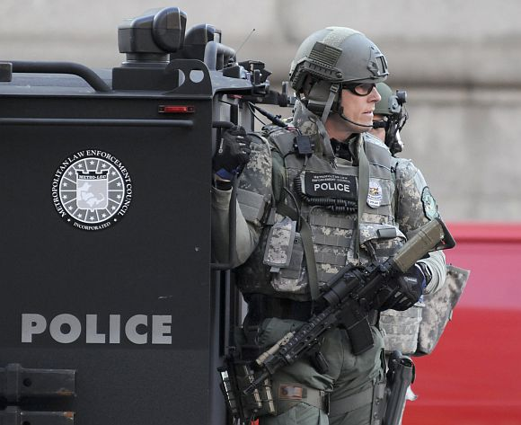 SWAT officers patrol the Copley Square area after explosions near the finish line of the Boston Marathon in Boston