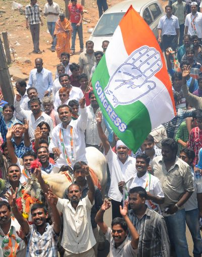 Congress workers cheer for Siddharamaiah during a campaign rally in Varuna