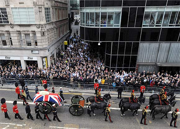 The funeral procession travels along Fleet Street to her funeral service at St Paul's Cathedral