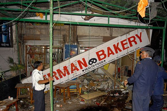 Security personnel inspect the site of a bomb blast in Pune in September, 2010
