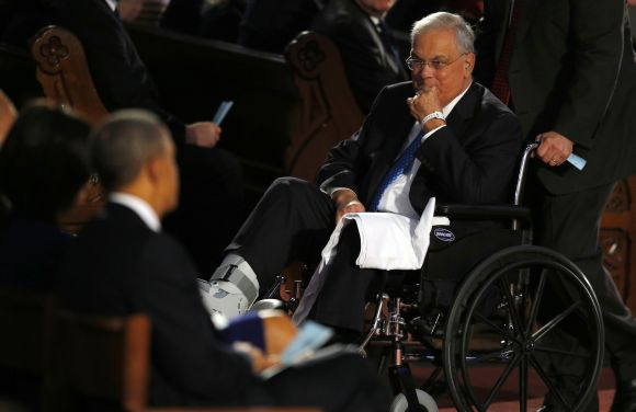 Boston Mayor Tom Menino (R) takes his place near U.S. President Barack Obama during an interfaith memorial service for the victims of the bombing at the Boston Marathon in Boston, Massachusetts
